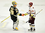 12 November 2010: University of Vermont Catamount goaltender Rob Madore, a Junior from Pittsburgh, PA, shakes hands with Boston College Eagle defenseman Patch Alber, a Sophomore from Clifton Park, NY, after a game at Gutterson Fieldhouse in Burlington, Vermont. The Eagles edged out the Cats 3-2 in the first game of their weekend series. Mandatory Credit: Ed Wolfstein Photo