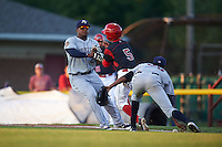 Mahoning Valley Scrappers first baseman Emmanuel Tapia (28) collides with base runner Aaron Knapp (5) while trying to field the ball, being picked up by pitcher Luis Jimenez (38), during a game against the Batavia Muckdogs on August 18, 2016 at Dwyer Stadium in Batavia, New York.  Batavia defeated Mahoning Valley 2-1.  (Mike Janes/Four Seam Images)
