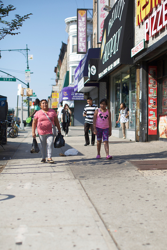 BROOKLYN, NY - August 15, 2015: A walk through Fifth Avenue in Sunset Park.<br /> <br /> Credit: Clay Williams.<br /> <br /> &copy; Clay Williams / http://claywilliamsphoto.com