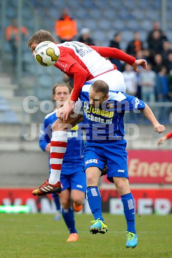 EMMEN - Voetbal, FC Emmen - FC Volendam, Jens Vesting, seizoen 2013-2014, 01-03-2014,   FC Emmen speler Roland Bergkamp met FC Volendam speler Nick Coster