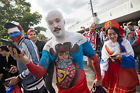 MOSCOW, RUSSIA - June 14, 2018: Russia fans head to the opening match of the FIFA 2018 World Cup at Luzhniki Stadium.