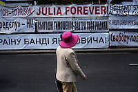 "UKRAINE, Kiev, 2/06/2012.Une Ukrainienne portant un chapeau passe devant une affiche disant ""Julia Forever"" quelques jours avant le coup d'envoi de l'Euro 2012 de Football co-organisé par l'Ukraine et la Pologne..UKRAINE, Kiev, 2012/06/2..A Ukrainian wearing a hat passes a poster telling ""Julia Forever "" few days before the kickoff of the Euro 2012 Football co-hosted by Ukraine and Poland..© Pierre Marsaut / Est&Ost Photography"