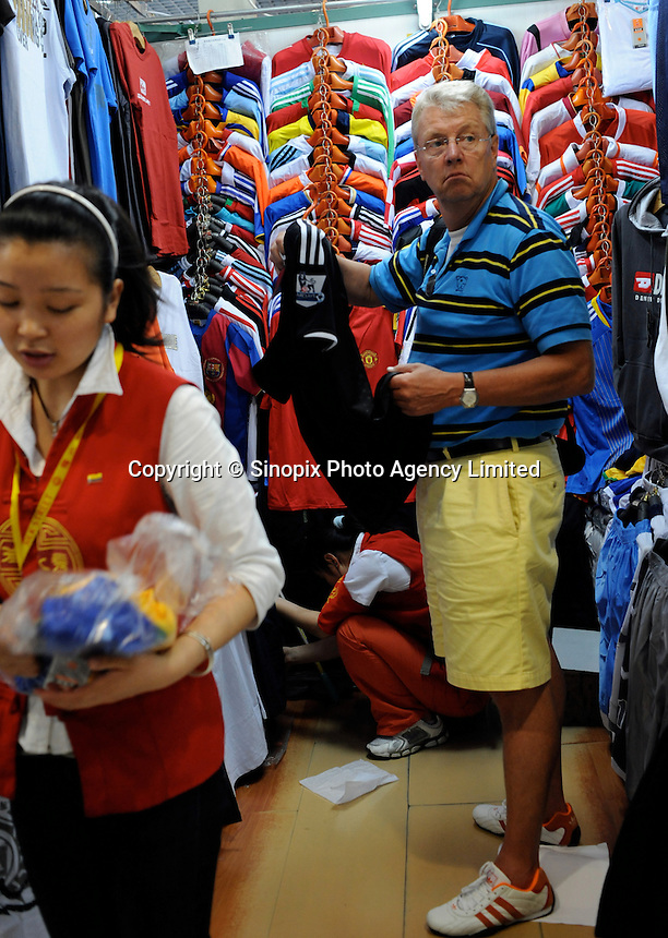 Fake football shirts at the Silk Market. The &quot;Silk Market&quot; in Central Beijing is proving a major tourist attraction with thousands of Olympic tourists flocking there daily in order to purchase fake designer goods ranging from clothing to watches.  The Beijing authorities closed hundreds of night-clubs and introduced many restriction on and rules ahead of the 2008 Olympics in the city mysteriously has allowed the trade of fake goods to foreigners continue, thumbing their nose at western companies.<br />
