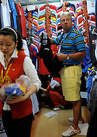 "Fake football shirts at the Silk Market. The ""Silk Market"" in Central Beijing is proving a major tourist attraction with thousands of Olympic tourists flocking there daily in order to purchase fake designer goods ranging from clothing to watches.  The Beijing authorities closed hundreds of night-clubs and introduced many restriction on and rules ahead of the 2008 Olympics in the city mysteriously has allowed the trade of fake goods to foreigners continue, thumbing their nose at western companies.<br />