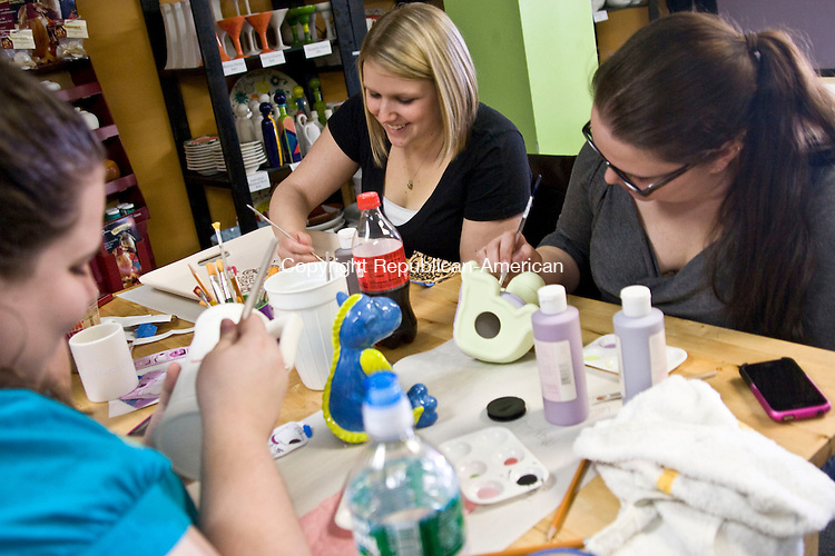 WATERTOWN, CT - 16 MARCH 2010 -031610JT03-<br /> From left, Becky Martin, Alison Hoffman and Colleen Tito paint pottery during a visit to Glazey Dayz Paint Your Pottery Studio in Watertown on Tuesday. To the left, not pictured, is Barbara Bellerive. The Studio will soon offer warm glass classes, making it the only Paint Your Pottery Studio in the state to do so. Warm glass requires no painting, and refers to fusing, slumping, and other glass processes which take place at temperatures between 1100 and 1700 degrees Fahrenheit (600 to 925 Celcius). Fusing is the process of using a kiln to join together pieces of glass, making the glass stick or &quot;fuse&quot; to each other. When the glass is heated and then cooled properly, the resulting fused glass piece will be solid and unbroken.<br /> Josalee Thrift Republican-American