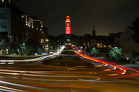 The clock tower is lit orange with the number ?100? in honor of the centennial.