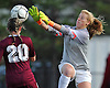 Kaitlyn Larsson #99, Garden City goalie, right, makes a leaping save during a Nassau County Class A varsity girls soccer quarterfinal against North Shore at Garden City High School on Wednesday, Oct. 26, 2016. Garden City won by a score of 1-0.