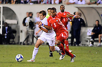 Roman Torres (5) of Panama challenges Robbie Rogers (7) of the United States (USA) for the ball. The United States (USA) defeated Panama (PAN) 2-1 during a quarterfinal match of the CONCACAF Gold Cup at Lincoln Financial Field in Philadelphia, PA, on July 18, 2009.