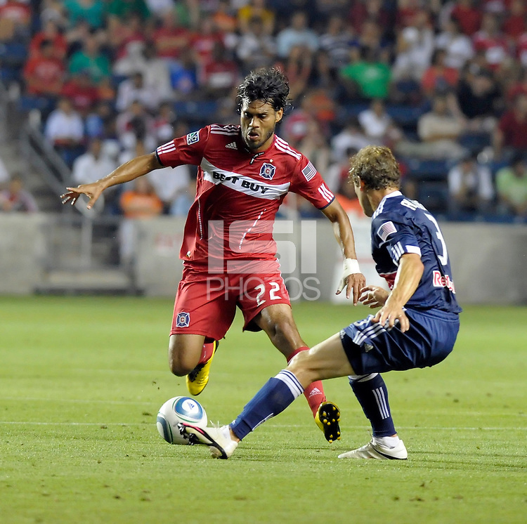 Chicago defender Wilman Conde (22) makes a move against New York defender Chris Albright (3).  The Chicago Fire tied the New York Red Bulls 0-0 at Toyota Park in Bridgeview, IL on August 8, 2010