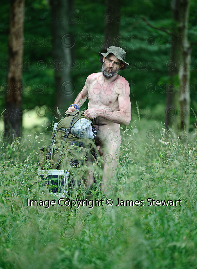 *** WARNING CONTENT MAY NOT BE SUITABLE FOR ALL ***.Naked Rambler Stephen Gough battles the elements as he sets up camp in the woods near Kinross.