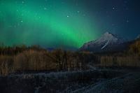 Aurora Borealis over Pioneer Peak, Alaska.
