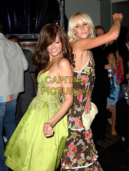 PARIS HILTON & KIMBERLEY STEWART .The US Weekly Young Hot Hollywood Style Awards held at Element in Hollywood, California  .April 13th, 2005.half length green dress brown floral print dress dancing funny gesture .www.capitalpictures.com.sales@capitalpictures.com.Supplied By Capital PIctures