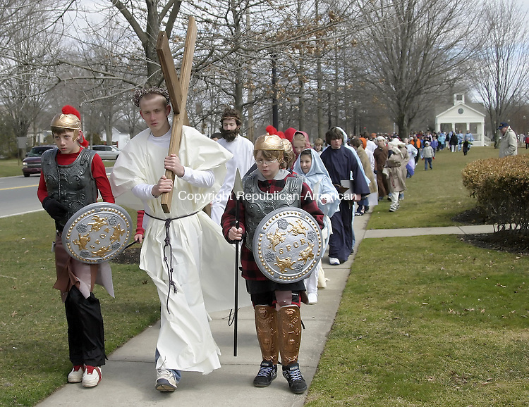 SOUTHBURY, CT -06 APRIL 2007 - -040607DA02-- Tyler Ferraro portrays Jesus along with Roman soldiers, Left Trevor Ferraro,  and, Ben Swanson as they walk along Main Street South with followers in Southbury for The Good Walk Friday for the stations of the cross.<br />  Darlene Douty/Republican-American