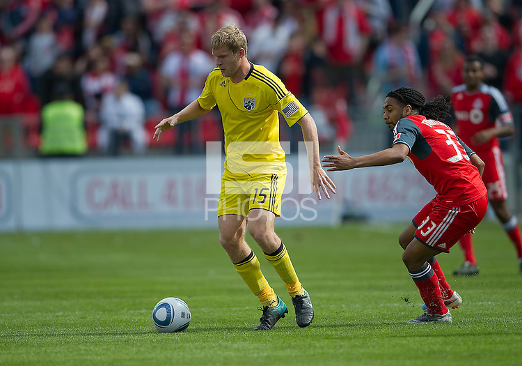 23 April 2011: Columbus Crew midfielder Kevin Burns #15 and Toronto FC forward Javier Martina #33 in action during an MLS game between the Columbus Crew and the Toronto FC at BMO Field in Toronto, Ontario Canada..The game ended in a 1-1 draw.