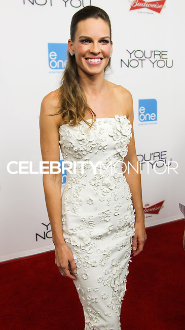 LOS ANGELES, CA, USA - OCTOBER 08: Actress Hilary Swank arrives at the Los Angeles Premiere Of eOne Films' 'You're Not You' held at the Landmark Theatre on October 8, 2014 in Los Angeles, California, United States. (Photo by Celebrity Monitor)