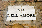 Pienza, Tuscany, Italy. Via dell' amore sign on wall.
