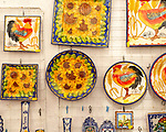 Close up of shop display of ceramic pottery souvenir products on sale, city of Evora, Alto Alentejo, Portugal, southern Europe