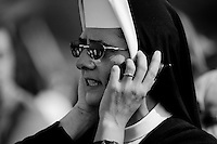 A Czech nun calls during the open-air mass served by the Pope Benedict XVI in Stara Boleslav, one of the main pilgrimage site of the Czech Republic, September 28, 2009.