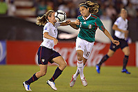 Heather O'Reilly of USA (L) and Guadalupe Worbis of Mexico during the semifinal match of CONCACAF Women's World Cup Qualifying tournament held at Estadio Quintana Roo in Cancun, Mexico. Mexico 2, USA 1.