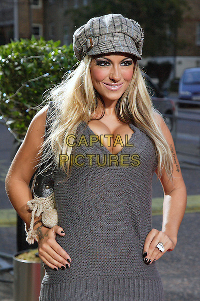 "JODIE MARSH.Celebrity Guests attend ""Another Audience with Al Murray - Pub Landlord"" at London ITV Studios, South Bank, London, England, October 21st 2007..half length grey hat cleavage dress boobs hands on hips knitted bag sweater .CAP/ROS.©Steve Ross/Capital Pictures"