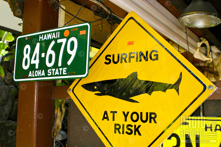 An assortment of decorative signs are available to shoppers at this beachside store in Waikiki on Oahu.