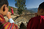 Buddhist monks blow ceremonial horns to announce the beginning of the Paro Festival in Bhutan. The festival takes place in early spring and the deep tones that resonate from these magnificent horns reverberate through the mountain valleys, calling the monks to the festival.