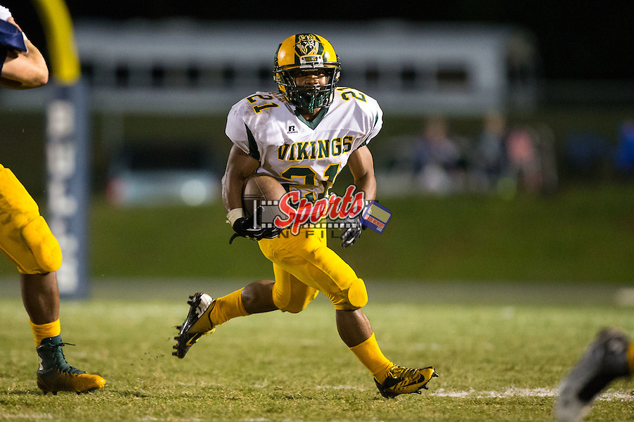 Xavier Harris (21) of the Central Cabarrus Vikings runs with the football during second half action against the Hickory Ridge Ragin' Bulls at Hickory Ridge High School on September 26, 2014 in Harrisburg, North Carolina.  The Ragin' Bulls defeated the Vikings 21-17.  (Brian Westerholt/Sports On Film)