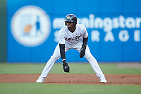 Luis Robert (9) of the Charlotte Knights takes his lead off of first base against the Scranton/Wilkes-Barre RailRiders at BB&T BallPark on August 13, 2019 in Charlotte, North Carolina. The Knights defeated the RailRiders 15-1. (Brian Westerholt/Four Seam Images)