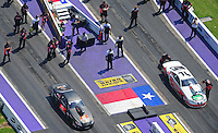 Apr. 28, 2012; Baytown, TX, USA: Aerial view of NHRA crew members for pro stock driver Erica Enders (left) alongside Mike Edwards during qualifying for the Spring Nationals at Royal Purple Raceway. Mandatory Credit: Mark J. Rebilas-