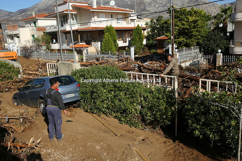 Pictured: A car is half submerged in mud caused by heavy rain in the area of Kinetta, near Athens, Greece. Monday 25 November<br /> Re: Heavy overnight rainfall has caused flooding and landslides in parts of Greece.