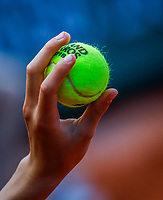 Paris, France, 27 May, 2018, Tennis, French Open, Roland Garros, Ballboy holding Roland Garros ball<br /> Photo: Henk Koster/tennisimages.com