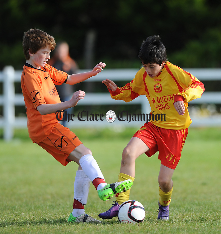 Ivan Neilan of Coole F.C. in action against Phillip Talty of Avenue United during their U-12 cup final at Doora. Photograph by John Kelly.