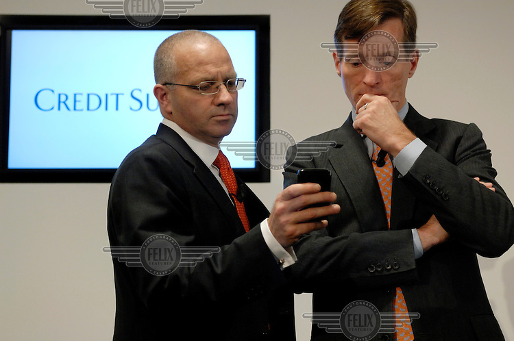 Credit Suisse CEO Brady Dougan reads s message on a Blackberry held by his then head of Investment Banking Paul Colello, at the end of a press conference announcing the bank's results. Not disclosed at the conference were the massive bonuses to be paid out to senior management. Dougan was Europe's highest paid banker in 2009, with a total income of CHF 90 million thanks to bonuses, which were not announced on the day. The Swiss banking industry holds an estimated 4,000 billion Swiss Francs (USD 4,240 billion) in assets, more than half of it foreign, including CHF 880 billion in undeclared European assets alone, benefiting from the country's famous banking secrecy laws.