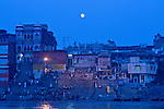 A view of the Ghats from the river before sunrise in Varanasi, Uttar Pradesh, India.