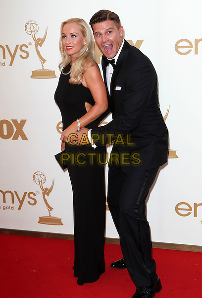 Jaime Bergman & David Boreanaz.63rd Primetime Emmy Awards - Arrivals Held at The Nokia LA Live, Los Angeles, California, USA..September 18th, 2011.emmys full length black white bow tie tuxedo sleeveless dress arms around waist married husband wife mouth open side funny.CAP/ADM/KB.©Kevan Brooks/AdMedia/Capital Pictures.