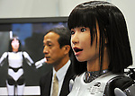 Nobember 9, 2011, Tokyo, Japan - Miimu, the cybernetic hunanoid robot, entertains visitors, singing a song during the International Robot Exhibition 2011 opened in Tokyo on Wednesday, November 9, 2011. The three-day trade show, sponsored by the Japan Robot Association, was designed promote new products and develop new business through contributing the promotion of new technology. (Photo by Natsuki Sakai/AFLO) [3615] -mis-..