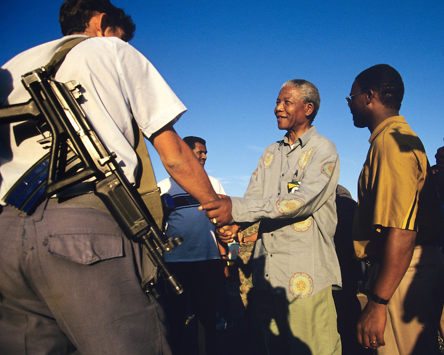 Nelson Mandela greets a police officer at a campaign event.  After more then 27 years in jail as an anti-apartheid activist,   Nelson Mandela lead a 1994 campaign for President as a member of the African National Congress (ANC),  in the first free elections in South Africa in 1994.  Mandela has received more than 250 awards over four decades, including the 1993 Nobel Peace Prize.