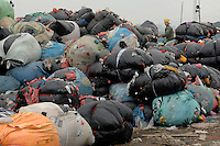 The landfill of Tangxia in Guangdong Province, China. As well as some domestic waste the landfill mostly comprises of waste, such as offcuts discarded from shoe and textile factories. Tangxia is a heavily polluted town..20 Mar 2007