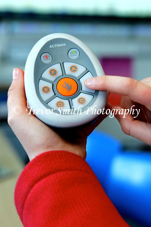 Children using Promethean Avtivote voting pads in a school classroom
