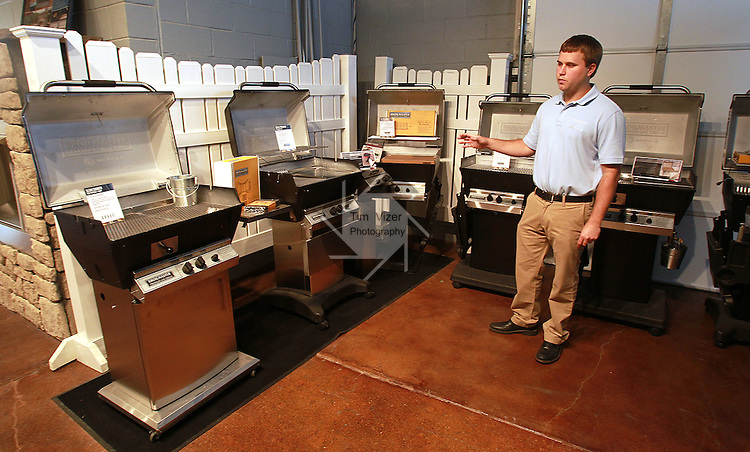 Nick Bauer, Vice-President of Product Development for Empire Comfort Systems, with gas grills the company manufactures. The Belleville manufacturing firm is celebrating its 80th anniversary.