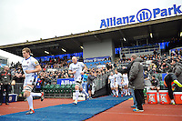 Stuart Hooper, Matt Garvey and the rest of the Bath Rugby team run out onto the field. Aviva Premiership match, between Saracens and Bath Rugby on February 15, 2015 at Allianz Park in London, England. Photo by: Patrick Khachfe / Onside Images