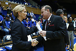 20 March 2015: Tulane head coach Lisa Stockton (left) and Mississippi State head coach Vic Schaefer (right) shake hands before the game. The Mississippi State University Bulldogs played the Tulane University Green Wave at Cameron Indoor Stadium in Durham, North Carolina in a 2014-15 NCAA Division I Women's Basketball Tournament first round game.