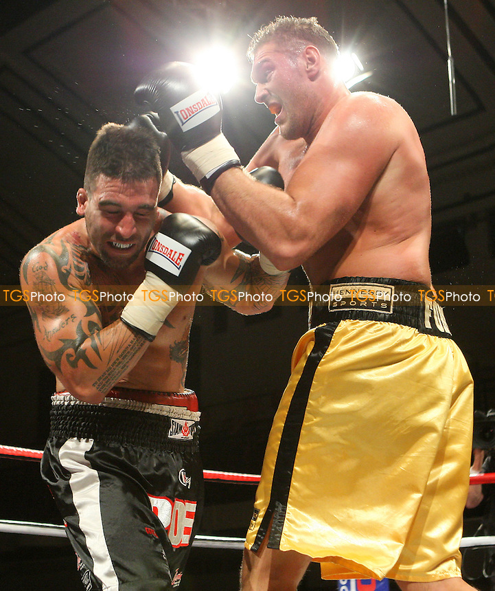 Tyson Fury (gold shorts) defeats Rich Power in a Heavyweight boxing contest at York Hall, Bethnal Green, promoted by Hennessy Sports / Shobox: The Next Generation - 10/09/10 - MANDATORY CREDIT: Gavin Ellis/TGSPHOTO - SELF-BILLING APPLIES WHERE APPROPRIATE. NO UNPAID USE. TEL: 0845 094 6026