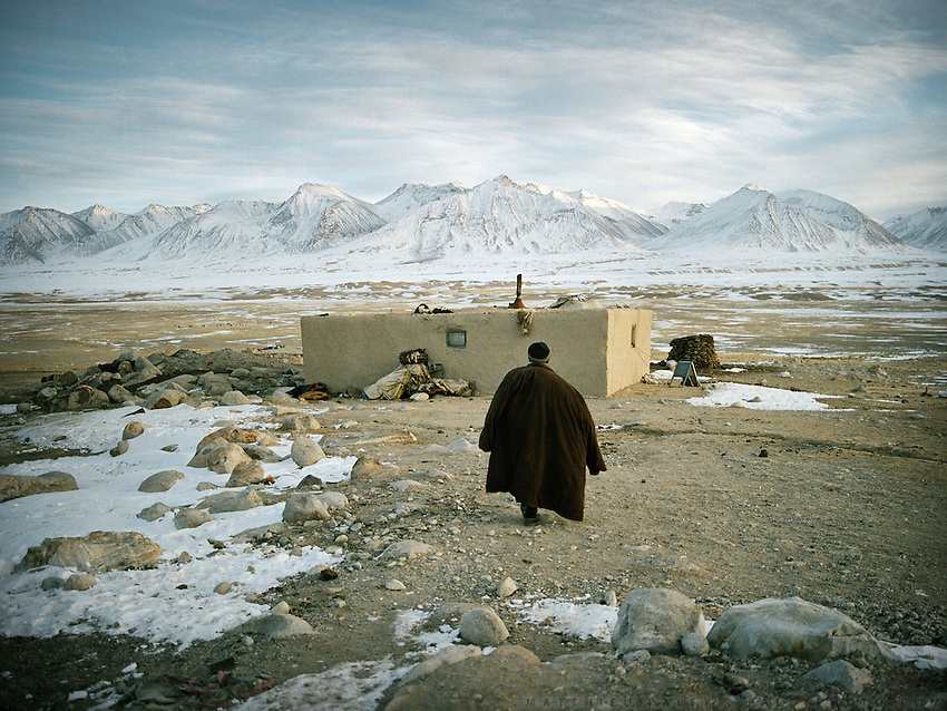 A sick Khan walks back to his winter house. Qyzyl Qorum campment, Abdul Rashid Khan's camp (leader of the Afghan Kyrgyz). ..Winter expedition through the Wakhan Corridor and into the Afghan Pamir mountains, to document the life of the Afghan Kyrgyz tribe. January/February 2008. Afghanistan