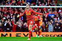 Sunday, 23 February 2014<br /> Pictured: Liverpool's Jordan Henderson celebrates scoring the opening goal. 1-0<br /> Re: Barclay's Premier League, Liverpool FC v Swansea City FC v at Anfield Stadium, Liverpool Merseyside, UK.