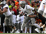 12/04/10-- Oregon running back Josh Huff runs through the Beaver defense during the Civil War game at Reser Stadium in Corvallis, Or..Photo by Jaime Valdez...