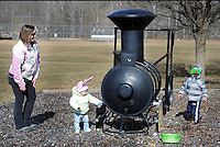 Amy Munn (L) watches as her children,  Fiona Munn (C), 1 year old, and Alex Munn (R), 2.5 years old, all of New Britain, have their own Easter Egg Hunt at North Branch Park Saturday March 28, 2015 at North Branch Park in New Britain Township, Pennsylvania. The New Britain East Egg Hunt was cancelled due to field conditions. (Photo by William Thomas Cain/Cain Images)