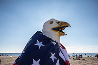 BROOKlLYN, NY - JANUARY 01 : A man wearing an eagle head costume takes part in the annual Coney Island Polar Bear Club New Year's Day swim by running into the ocean at Coney Island , Brooklyn on January 01, 2017. Photo by VIEWpress/Maite H. Mateo.