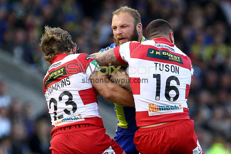 PICTURE BY ALEX WHITEHEAD/SWPIX.COM - Rugby League - Super League - Warrington Wolves vs Wigan Warriors - Halliwell Jones Stadium, Warrington, England - 24/06/13 - Warrington's Garreth Carvell is tackled by Wigan's Logan Tomkins and Chris Tuson.