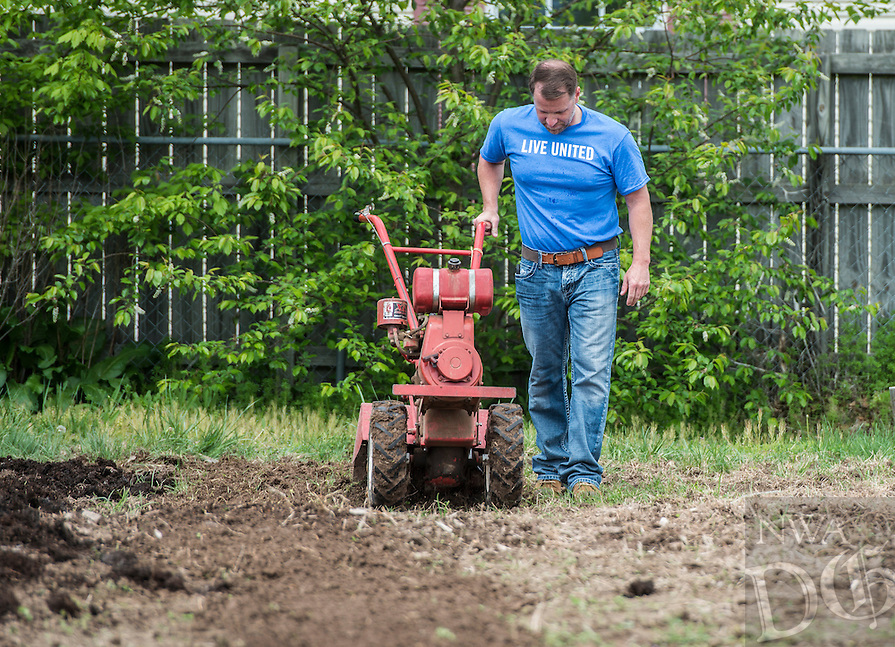 NWA Democrat-Gazette/ANTHONY REYES &bull; @NWATONYR<br /> Jason Richardson, with Walmart Global Audit Services, runs a tiller Wednesday, April 15, 2015 for the United Way&rsquo;s Live United Day at the Samaritan Community Center&rsquo;s garden. Richardson joined a crew from Global Audit Services to the work at the garden tilling, spreading compost, pulling weeds and to prep the garden for planting. The garden grew 5000 pounds of produce last year that was used in the center's meal programs.